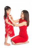 Asian Chinese family preparing for Chinese New Year festival, with traditional Cheongsam isolated on white background.
