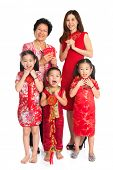 Group of happy  multi generations Asian Chinese family wishing you a happy Chinese New Year, with tr