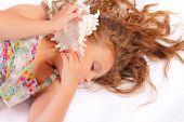 Quiet Little Girl With Seashell