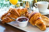 pic of french pastry  - Breakfast with coffee and croissants in a basket on table - JPG