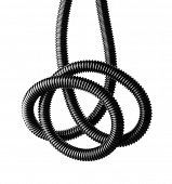 Black and white image of a black tangled flexible hose.
