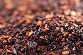chipotle - jalapeno smoked chili flakes background, shallow dof