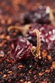chipotle - jalapeno smoked chili flakes and whole background, shallow dof
