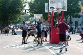 Man Drives And Shoots Layup In Street Basketball Tournament