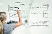 stock photo of drawing  - designer drawing website development wireframe with marker - JPG