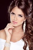 Beautiful Brunette Woman. Hairstyle. Makeup. Manicured Nails. Fashion Elegant Girl In White Dress  I