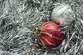 Two Christmas Balls On Tinsel