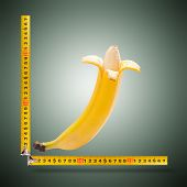 stock photo of kamasutra  - Large banana and measuring tape as image of man - JPG