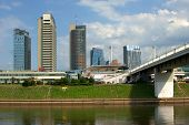 The Vilnius City Walking Bridge With Skyscrapers