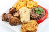 picture of cassava  - Deep fried pork yukka or cassava plus congri rice all with salty green banana fries - JPG