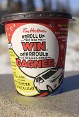 Tim Hortons' coffee cup showing their annual roll up to win contest in English and French languages