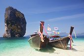 Thailand ocean landscape. Exotic beach view and traditional ship on Ko Poda