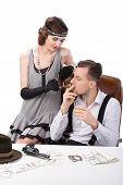 stock photo of gangster  - Male and female gangsters sitting at a table counting money - JPG