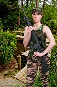 picture of assault-rifle  - Beautiful young woman holding an automatic assault rifle - JPG