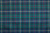 stock photo of tartan plaid  - Scottish tartan background a checked plaid weave pattern with red green blue and yellow colours - JPG