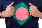 foto of bangladesh  - Young sport fan opening his shirt and showing the flag his country Bangladesh Bangladeshi flag - JPG