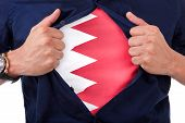 Young Sport Fan Opening His Shirt And Showing The Flag His Country Bahrain , Bahraini Flag