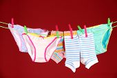 image of wet pants  - Baby clothes hanging on clothesline - JPG