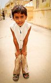 JAILSAMER, INDIA - SEPT 17 2012:  Poor curious unidentified little boy beg in street.  The latest UN