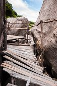 stock photo of yuan  - The old wooden bridge of Koh Nang Yuan with sky - JPG