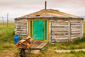 stock photo of yurt  - Unusual wooden Mongolian yurt known as a ger in Northern Mongolia - JPG