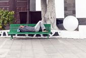 Arrecife, Spain - April 3: Man Holds A Siesta On A Bench