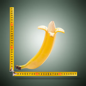 image of kamasutra  - Large banana and measuring tape as image of man - JPG