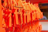 YOSHINO, JAPAN - April 27th : Votive tablets made of the shape of orange torii in Fushimi Inari Taisha Shrine, Kyoto, Japan on April 27th, 2014.