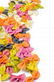 Colored farfalle pasta, on the left edge