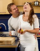 Happy Couple Laughing In The Kitchen