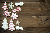 Wooden Background With Christmas Cookies And Copy Space