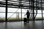 Traveler waiting at airport terminal