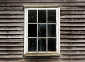 Old Window With A Curtain Of The Wooden House