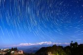Star trails over Bandipur village and the Himalayas, Nepal