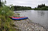 River Landscape With Kayaks.