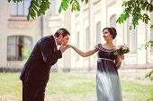 foto of hand kiss  - Happy marriage concept. Groom kissing brides hand outdoor ** Note: Soft Focus at 100%, best at smaller sizes - JPG