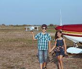 Little Boy And Little Girl Pilot With Handmade Plane