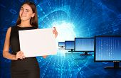 Businesswoman with rows monitors and glowing figures