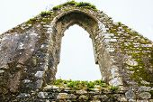 Arch Window Of Old Stone Fortress Or Church And Sky