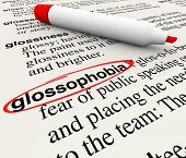 Glossophobia word defined in dictionary showing the dfinition as a fear of public speaking or stage