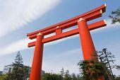 Red otorii of Heian Jingu Shrine under the blue sky in Kyoto Japan.