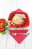 mediterranean cuisine: fresh rose wild salmon baked in cream cheese sauce with italian pasta and red