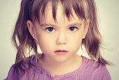 pic of sad eyes  - face of a little beautiful girl with sad eyes - JPG