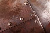 stock photo of ironclad  - close up shot of an iron armour plate with rivets - JPG