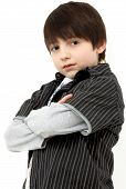 image of brown-haired  - Adorable six year old french american boy with dark shaggy hair and brown eyes - JPG