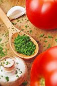 Chopped Parsley On Wooden Spoon