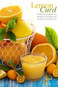 pic of curd  - Lemon curd in a small jar with fresh citrus fruits and leaves - JPG