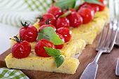 Polenta tart with baked tomatoes