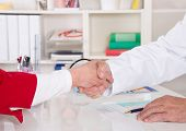 Handshake: Doctor Says Welcome To His Senior Patient.