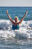 Middle-aged Woman On The Waves